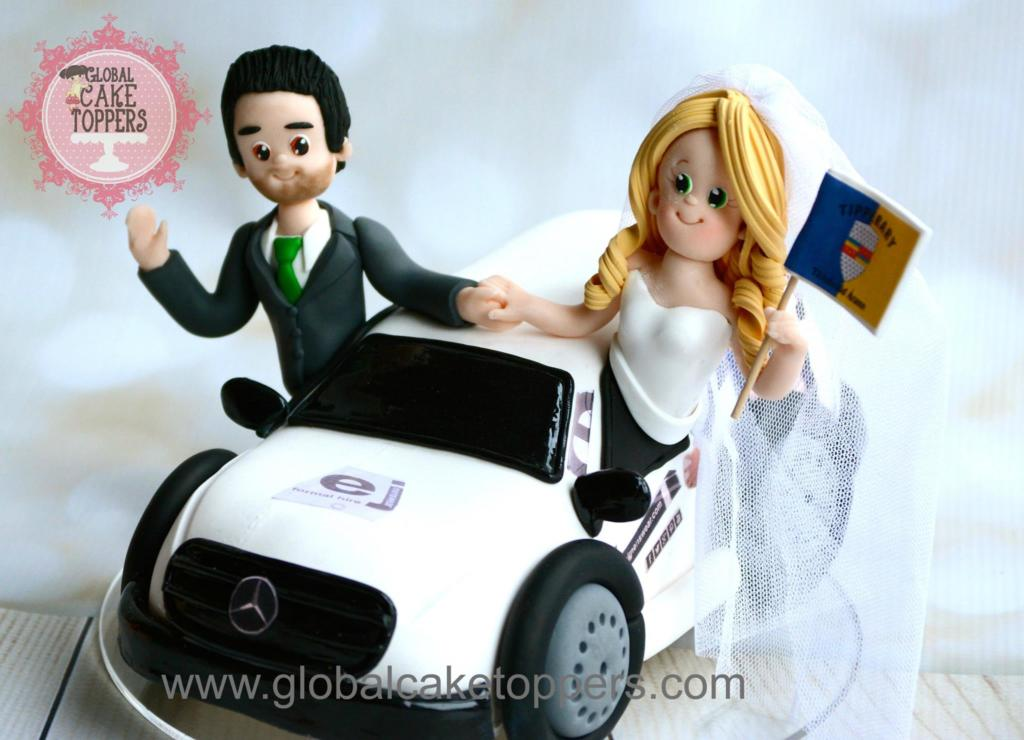 Bride and Groom waving from the car cake topper