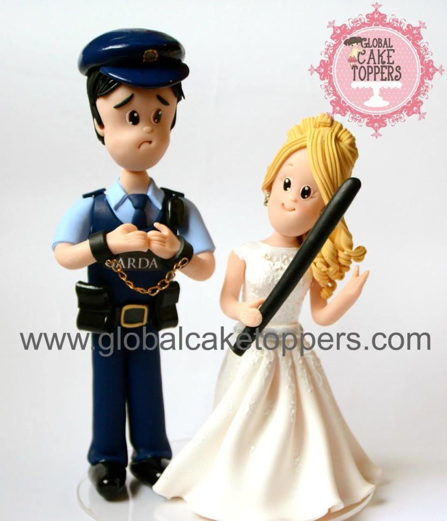 Groom in Garda uniform with Bride cake topper