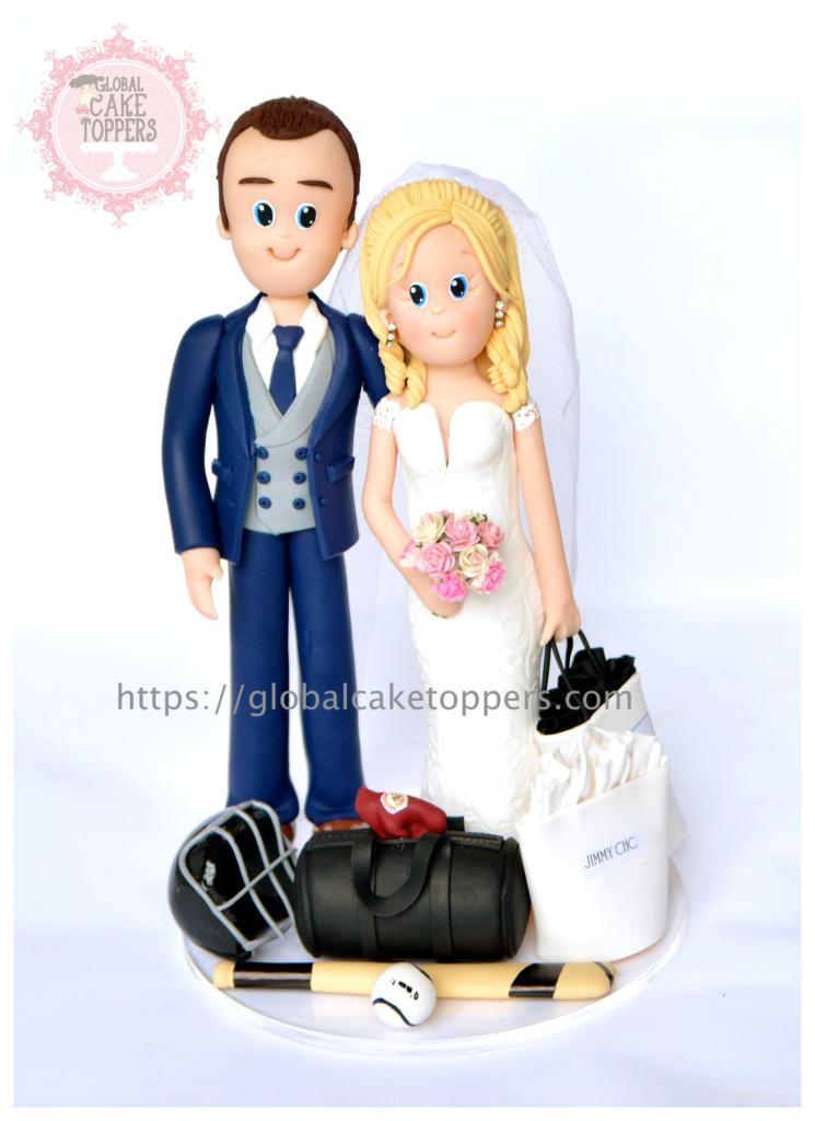 Sports loving groom with her bride cake topper