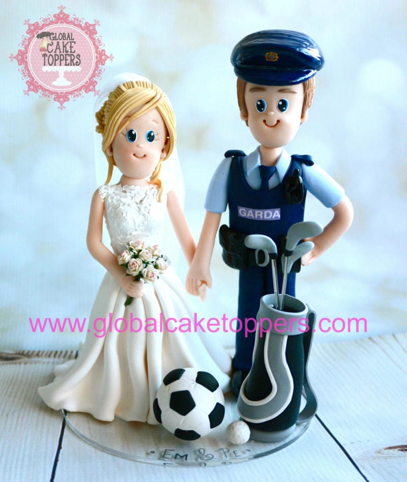 Garda Police with her golf club and bride cake topper