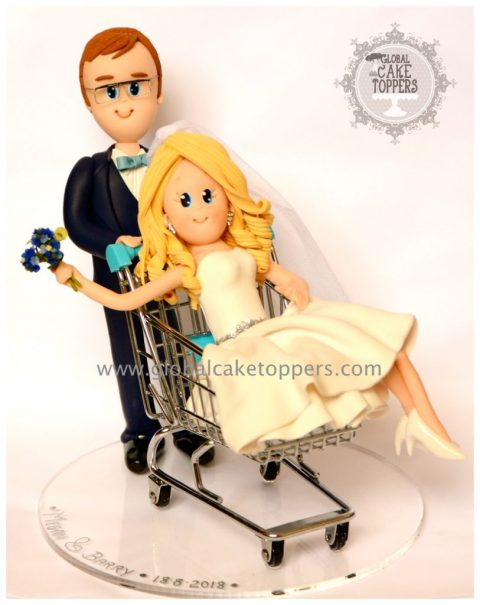 Bride in a shopping trolley wedding cake topper