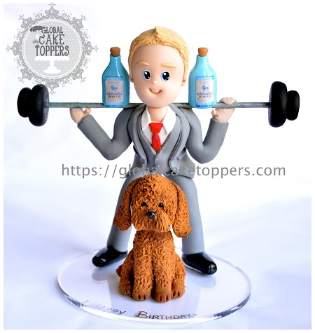 Groom lifting weights with pet dog cake topper