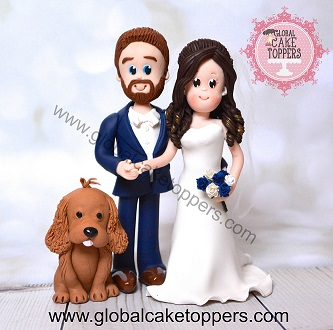 bride and groom with their dog cake topper