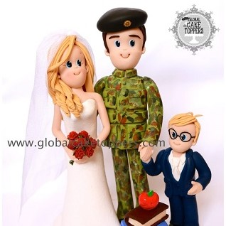 soldier groom with his bride and son cake topper