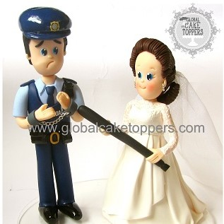 garda groom with his bride cake topper