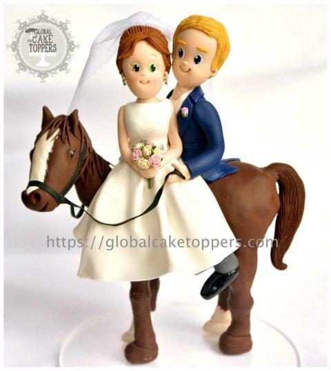 Lovely couple on horse cake topper