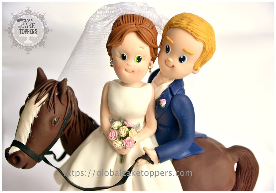 Bride and Groom on their horse cake topper