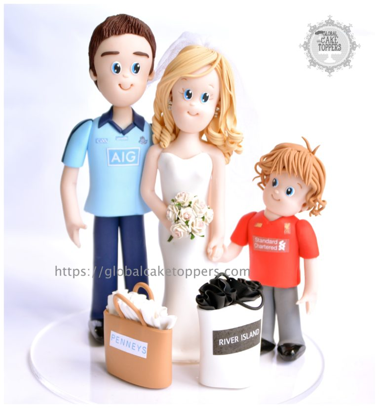 Cute little boy with family cake topper