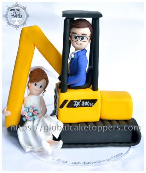 Groom lifting bride in digger cake topper