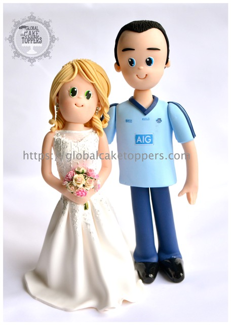 garda groom with his wife wedding topper